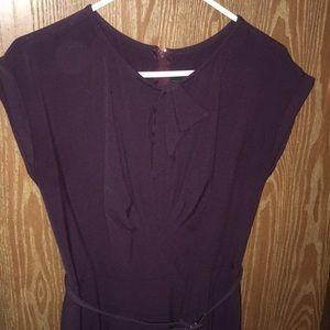 Dark purple knee length dress.